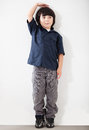 Boy checking his height Royalty Free Stock Photo