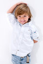Boy checking his height happy agaisnt the wall Royalty Free Stock Photos