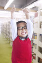 Boy cheers happily in the library Stock Photos