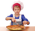 Boy chef eat pizza hungry Royalty Free Stock Photography