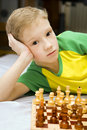 Boy and chess Stock Photography
