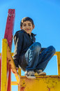 Boy child girl at playground beautiful happy smiling isolated over blue clear sky Stock Photography