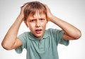 Boy child man upset angry shout produces evil face portrait isolated emotion gray Royalty Free Stock Image