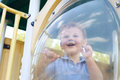 Boy child at playground laughing having fun a Stock Image