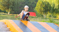Boy child training skateboard outdoor summer sport with nature on background Stock Images