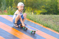 Boy child training skateboard outdoor summer sport with nature on background Royalty Free Stock Photo