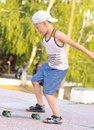 Boy child training skateboard outdoor summer sport with nature on background Stock Image
