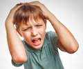 Boy child upset angry shout produces isolated evil face portrait emotion gray Royalty Free Stock Photo