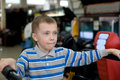 Boy in the children's amusement arcade Stock Photos