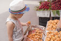Boy choose fruits chinese on stall Royalty Free Stock Image