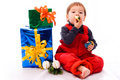 Boy with Christmas presents and toys Stock Photo