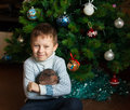 Boy and christmas tree hedgehog near Stock Images