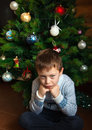 Boy and christmas tree near beautiful Stock Photos