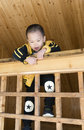 Boy climbing guardrail chinese wooden in chalet Royalty Free Stock Photo
