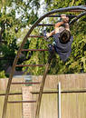 Boy climbing the monkey bars Royalty Free Stock Photo