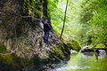 Boy climbing mountain wall Royalty Free Stock Photo