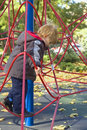 Boy climbing net of ropes Royalty Free Stock Photography