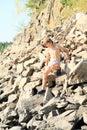 Boy climbing rock hill Royalty Free Stock Photo