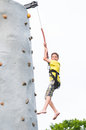 Boy climbing a rock wall Royalty Free Stock Photo