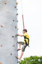 Boy climbing a rock wall Royalty Free Stock Photo