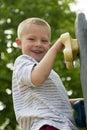 Boy Climbing Rock Wall Outdoors Royalty Free Stock Photo