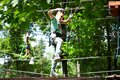 Boy is climbing in a rope park over the trees May 31, 2018 Kharkov Ukraine Royalty Free Stock Photo