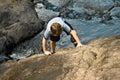 Boy climbing up a rock Royalty Free Stock Photo