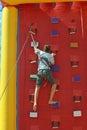 Boy climbing a wall Royalty Free Stock Photo