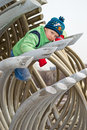 A boy climbs on a pipe long curved tube Stock Photo