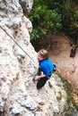 The boy is a rock climber. Royalty Free Stock Photo