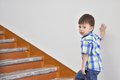 Boy climbs up the stairs of university characterizes rise due to knowledge Royalty Free Stock Photography