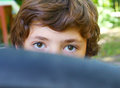 Boy close up portrait behind the bicycle tire Royalty Free Stock Photo