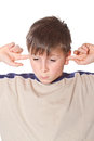 Boy with closed ears Royalty Free Stock Images