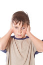 Boy with closed ears Royalty Free Stock Image