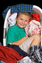 Boy in clothes basket Stock Photography