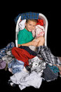 Boy in clothes basket Stock Image