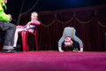 Boy Clown Doing Back Bend on Stage Royalty Free Stock Photo