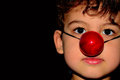 Boy clown the nose is fun Stock Photography