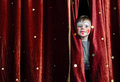 Boy Clown Peering Through Stage Curtains Royalty Free Stock Photo
