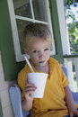 Boy with Cold Beverage in Summer Stock Images