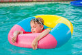 Boy in colorful float ring in swimming pool Royalty Free Stock Photo