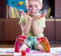 Boy with colorful painted hands and foot cute happy Royalty Free Stock Photos