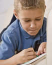Boy Coloring in Book Royalty Free Stock Photo