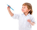 Boy coloring happy with a blue pencil isolated over white background Royalty Free Stock Photos