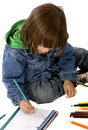Boy colouring on a notebook Royalty Free Stock Image