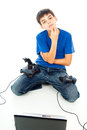 Boy with computer and with two joysticks Royalty Free Stock Images