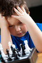 Boy concentrate on playing chess Royalty Free Stock Photography
