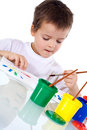 Boy concentrated painting Royalty Free Stock Image