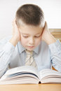Boy concentrated on reading Stock Image