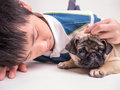 A boy consoles a sad puppy Royalty Free Stock Photo